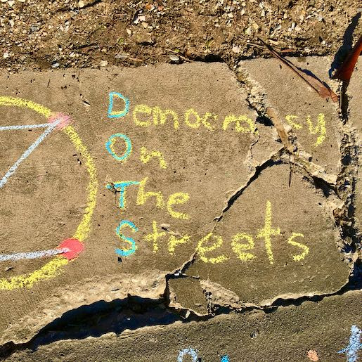 Democracy On The Streets. Gutter. Chalk.