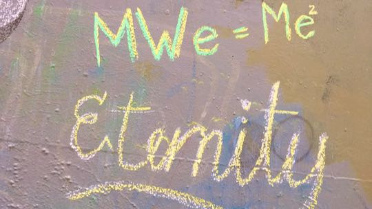 """Example: Eternity DOTS and 'MWe=Me2"""" written in chalk on wall"""