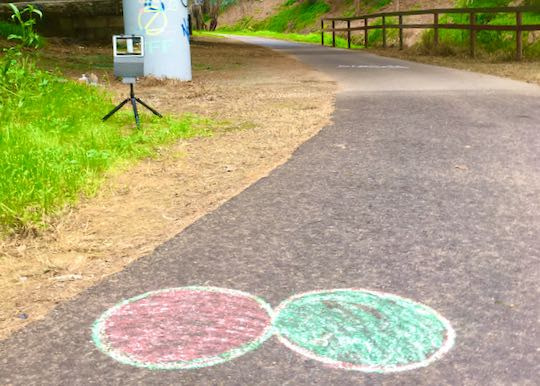 Example: Infinity DOTS written in chalk. Camera in background.