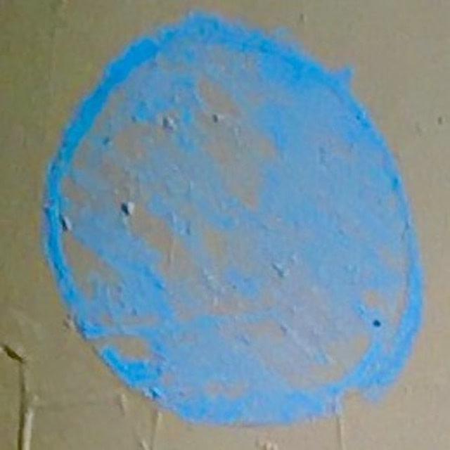 scrawled blue chalk dots
